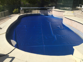 Newly installed thermal pool cover and roller