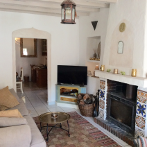Lounge rear view with log burner and chimney