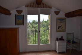 Studio: bedroom with patio doors, view to Mediterranean