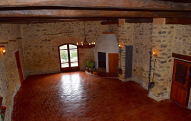 Middle part of building with woodburning stove, used for weddings and functions. Stairs to Studio