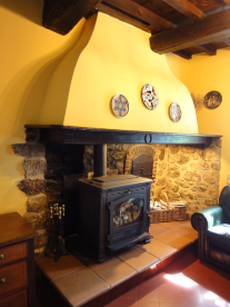 Farmhouse woodburning stove in lounge