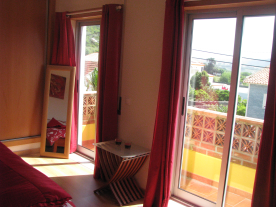 Patio doors and balcony of the master bedroom.