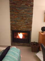 Feature fireplace with wood burner.