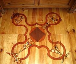 artwork on wooden floor in bedroom 1 on ground floor