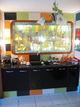 part of kitchen area with original Limoges porcelain solid colour glass panels