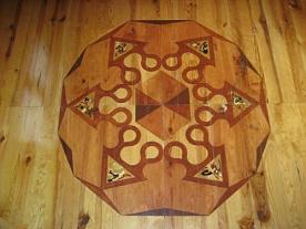 "artwork on wooden flooring in bedroom 2 on first floor (featuring Letter ""N"")"