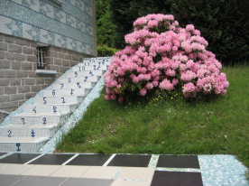 """""""The Stairway of Life"""" artwork stairs near garage, initialed by the artist"""