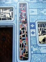 artwork detail on the facade entrance