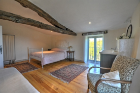 Bedroom with exposed beams & wooden floor