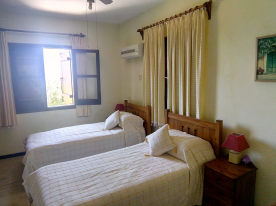 Double Bedroom Three (Downstairs) with Fitted Wardrobes, AC Unit, Ceiling fan  Sea Views
