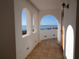 Photo 13 - Upper partially enclosed terrace - facing East/South