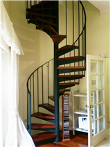 Spiral staircase from downstairs gym to master suite
