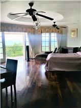Master bedroom with door open to wrap around balcony