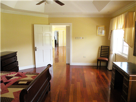 Another upstairs bedroom leading to expansive landing