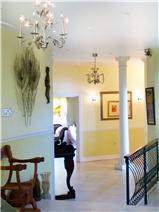 Downstairs hallway continued (bar to right, open door to piano room shown)