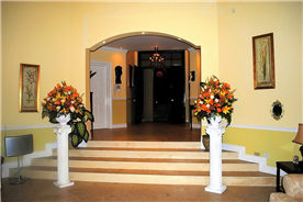 View of entrance hallway and steps to sunken formal sitting room (double heighted)