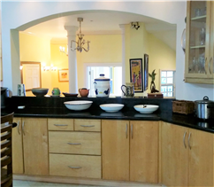 Kitchen with alcove from which the sea, bar and infinity pool deck can be seen