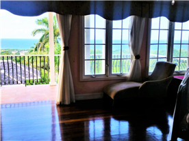 View from upstairs bedroom leading to expansive balcony with panoramic sea views