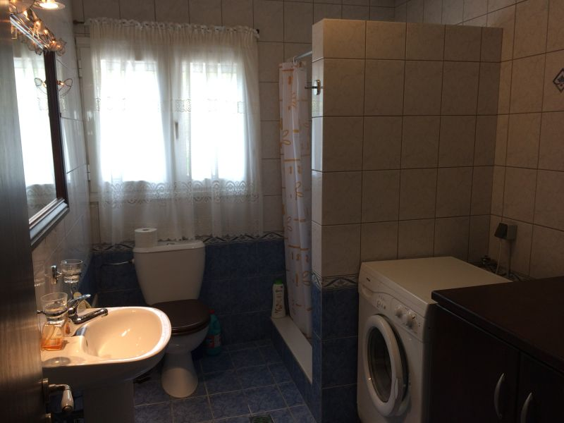 29. Bathroom 2; walk-in shower, large wood cabinet and washing machine