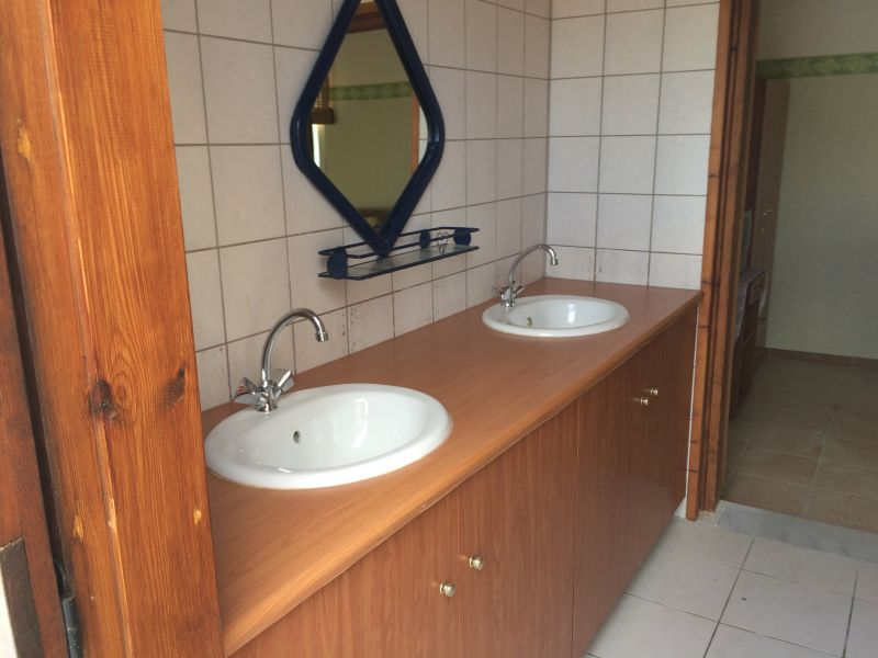 32. Pool house annexe bathroom; double basin unit with walk-in shower and toilet
