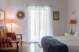 Madresilva master bedroom opening onto wrap around veranda