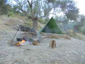 Simple wild-camping open shelter.