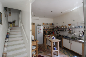 Kitchen and wooden stairs to 1st floor