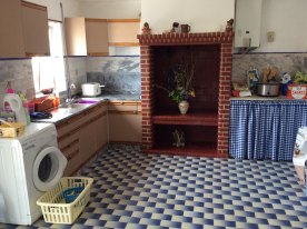 Rustic kitchen, with traditional fireplace and bread oven