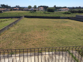 The field with a well and taps on all the walls