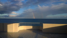 Early evening rainbow over the sea.