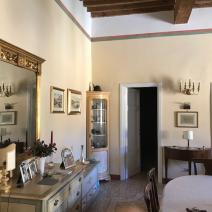 Sitting/Dining/Study area showing door to bedroom corridor and bathrooms