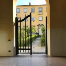 Main entrance gate of Villa from Via Del Giardino Botanico