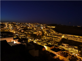 A photo of the town taken at night from the upstairs bedroom