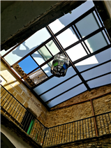 The glass roof over the interior patio