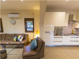 Lounge, kitchen, dusk Balmoral Villa.