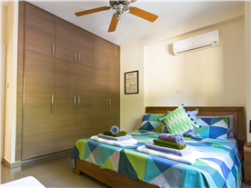 Downstairs double bedroom, king size bed, with fully fitted contemporary wardrobes Balmoral Villa.