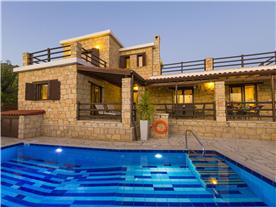 Dusk with pool lights Balmoral Villa.