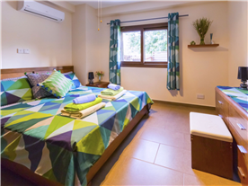 Double bedroom, with King bed, fully fitted contemporary wardrobes.