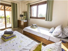 Down stairs twin double room, with access to outside covered area,  fitted contemporary wardrobes.