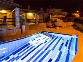 Pool area at Night Balmoral Villa.