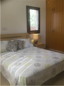 Bedroom, 1 bed cottage, with fully fitted wardrobes, air conditioning and ceiling fan.