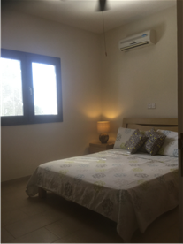 Bedroom, 1 bed cottage, with fully fitted wardrobes air conditioning and ceiling fan.