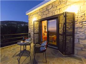 Master bedroom balcony, sea and mountain night views. Balmoral Villa.