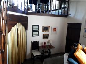 2 further bedrooms under mezzanine area through curtained door.