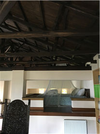 Bed in mezzanine under fabulous exposed timber roof!
