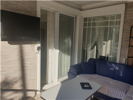 Wallmounted TV in conservatory