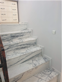Hallway stairs with real marble flooring