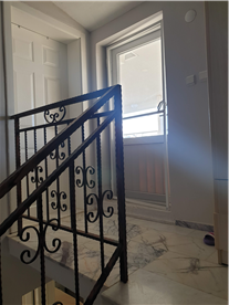 Stairs to second floor with marble flooring and access door to terrace