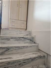 Stairs to second floor with marble flooring