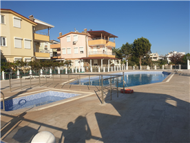 Adult Olympic size pool and children pool from side.